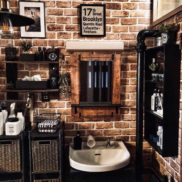 壁の色をトイレと揃えた洗面所