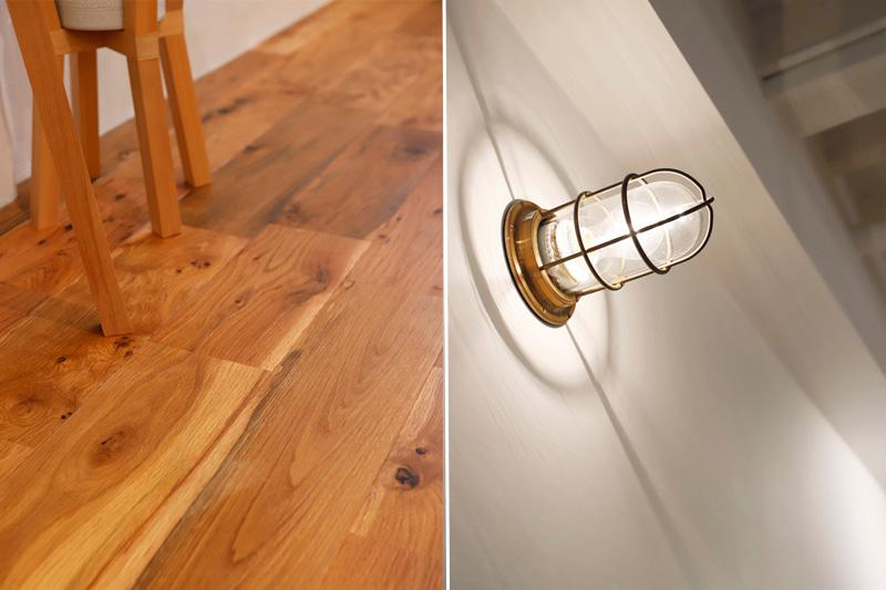 床材は無垢のオーク材、照明はマリンランプを使用